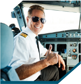 The Captain of an aircraft giving the thumbs up to Worldwide Charter Groups amazing planning and service.